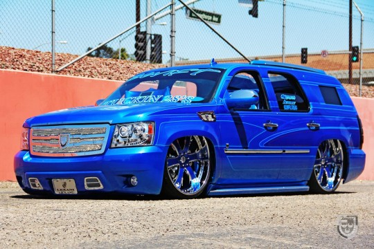 "Blue 2010 Chevy Tahoe with 28"" custom chrome and blue LT-704 with crystal inserts."