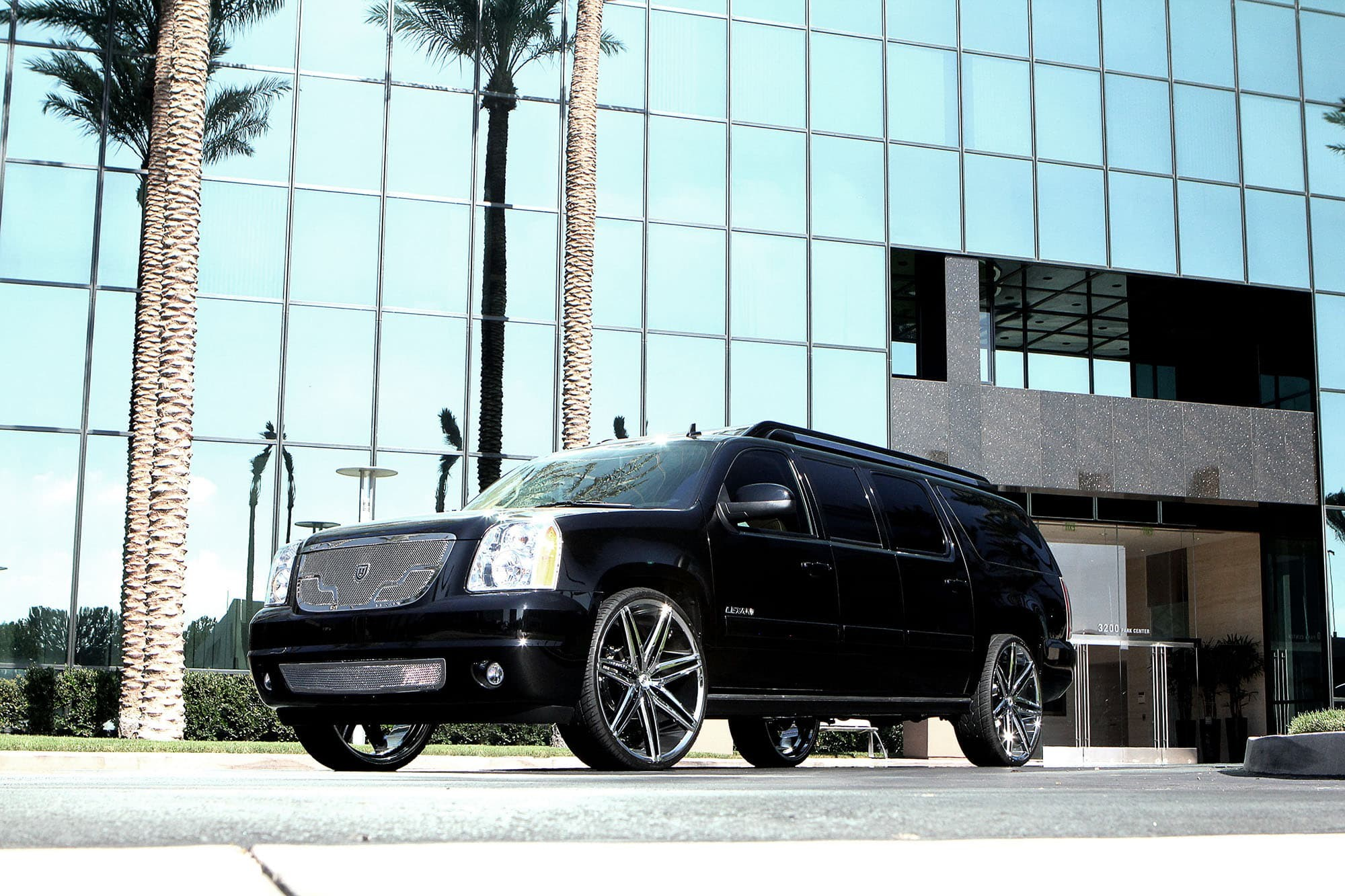 Black GMC XL with chrome Johnson II wheels