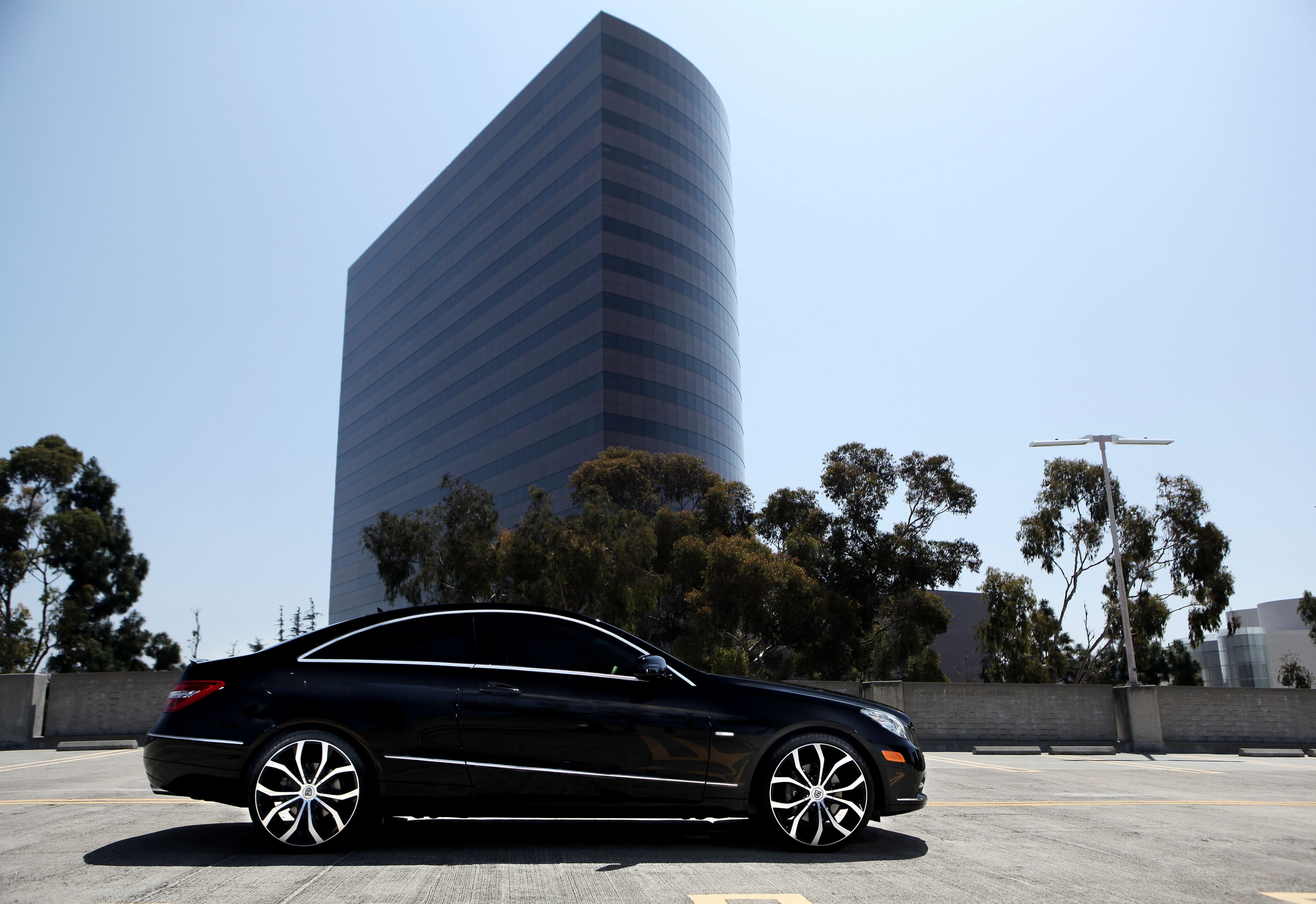 Black Mercedes E-350 with machined and black Lust wheels