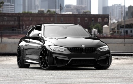 Black BMW M4 on black and white Stuttgart wheels