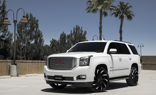 White GMC Yukon on black and white Matisse wheels