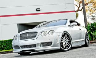 Silver 2010 Bentley GT with with 22 Lexani machine and black CVX-44.