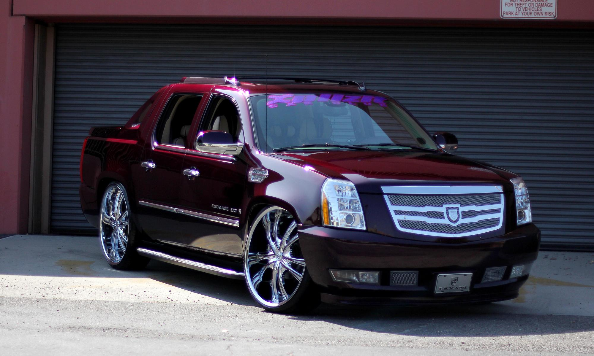 Lexani wheels the leader in custom luxury wheels 2010 burgundy cadillac escalade ext with chrome and purple