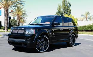 "2010 black Range Rover Sport with 24"" black and stainless steel with brilliant etch LT-703"