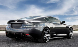Grey 2011 Aston Martin DV9 with machine and black R-Five.