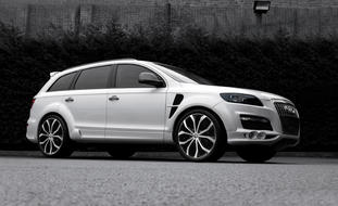 White 2011 Audi Q7 with 24 Lexani machine and black Lust.