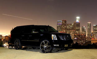 2012 Cadillac Escalade with chrome Johnson II wheels.