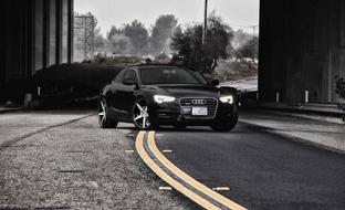 "2013 Black Audi A5 with 20"" machine and black R4."