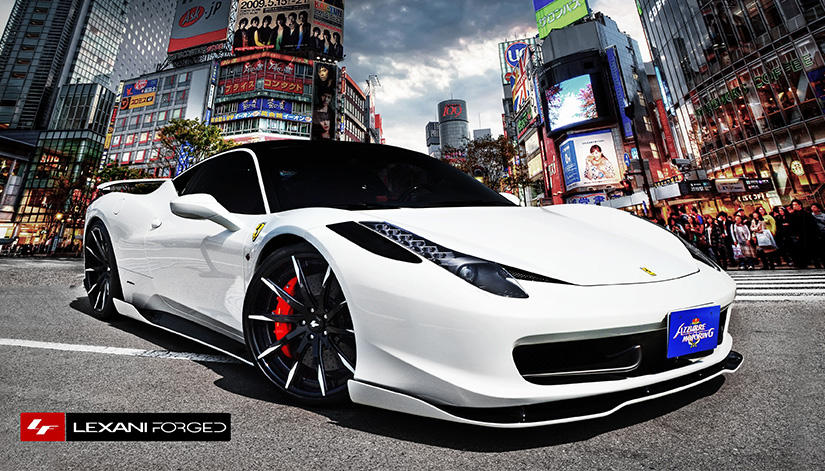 The 2013 Ferrari 458 with black/white LZ-101 rims.