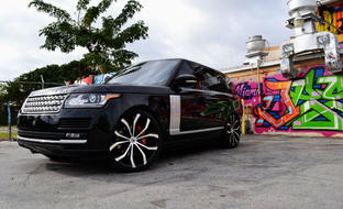 Black Range Rover with machined and black Lexani Lust wheels
